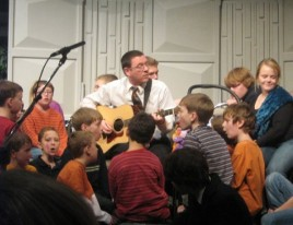 Jamie Soles singing along with a group of kids